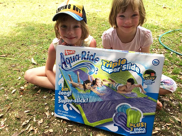 The girls were so excited when they found out they had a Superslide from Clark Rubber, and that it was a triple one. Of course my kids love getting wet and cooling off on a hot day. This is perfect to keep kids happy and cool on a hot summer day.