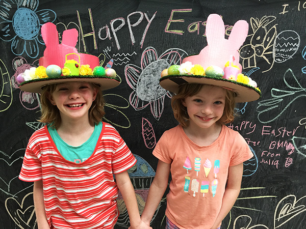 The girls think their new hats will impress at the local school and also the Easter Bunny.