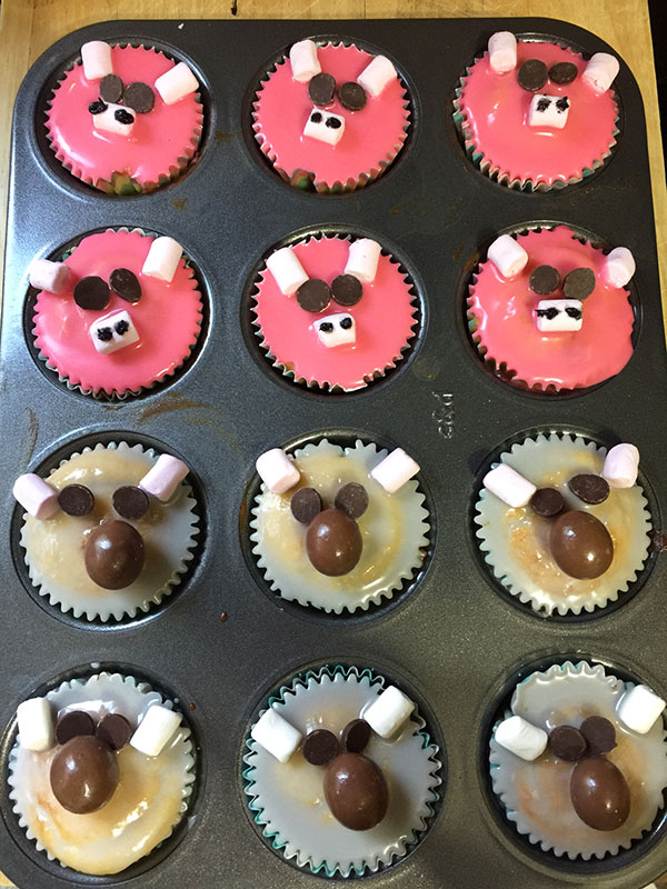 All the SING cupcakes ready for our movie night. Rosita (PIG) cupcakes and Buster Moon (Koala) cupcakes.