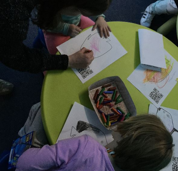 The twins and their cousin colouring in fish for the art aquarium at SEALIFE Sydney.