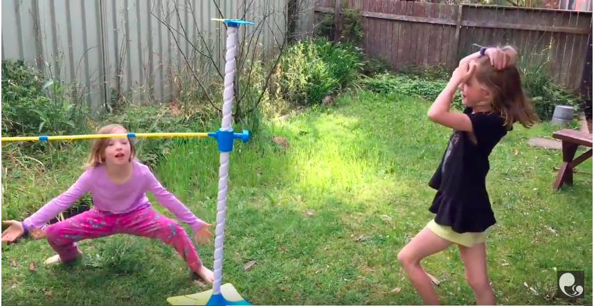 The girls having fun with funny moves while playing Limbo Hop.