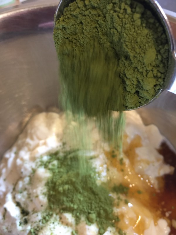 Adding the Matcha Green Tea powder to the mixture.