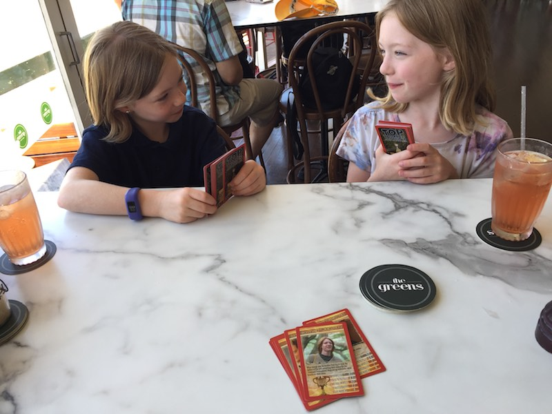 Playing Top Trumps Harry Potter while waiting for lunch.