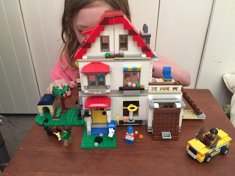 Now the LEGO Modular House is complete, it needs to have some security added to keep it safe. There is a dog, and a light, so making sure locks and a smart device is installed is key.