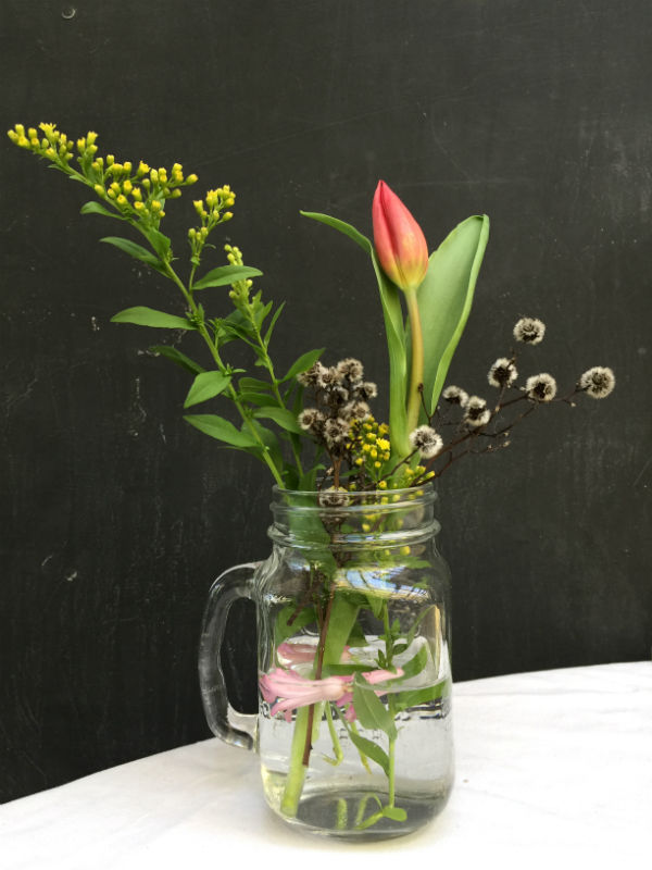 Mason Jar Flower Arrangement with a Red Tulip, Pink Hyacinth petals, Grey Stirlingia and Yellow Solid Astor.