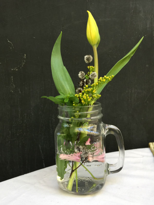 Mason Jar Flower Arrangement with a Yellow Tulip, Pink Hyacinth petals, Grey Stirlingia and Yellow Solid Astor.