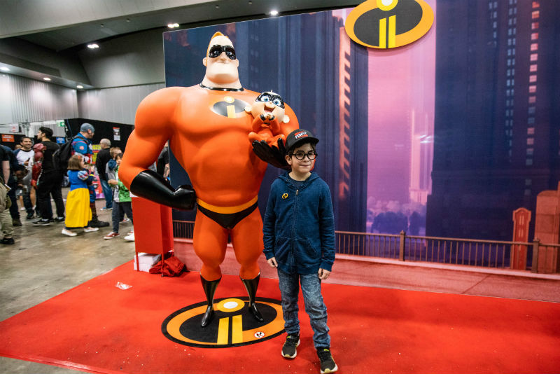 Mr Incredible, Jack Jack, and a huge fan.