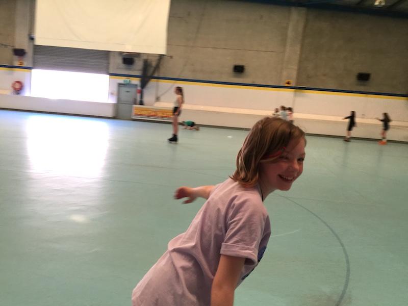 Lillian skating and having fun at her birthday party.