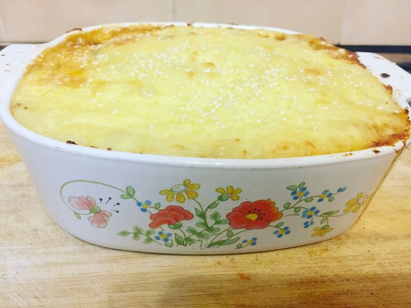 Lamb & Spinach Shepherd's Pie with added cheese on top.