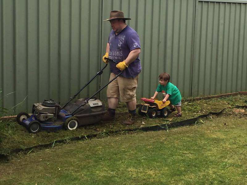 Alexander loves helping daddy with the lawn. He's so busy running around it is hard to keep up.