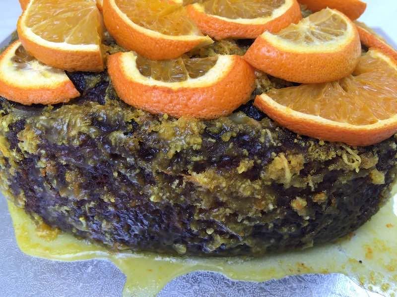 Orange & Poppy Seed Pound Cake with super orangey icing and fresh oranges.