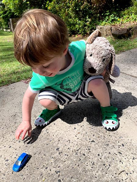 Alexander can't go anywhere without his cars and Bark the Dog. Playing cars on the driveway is hours of fun!