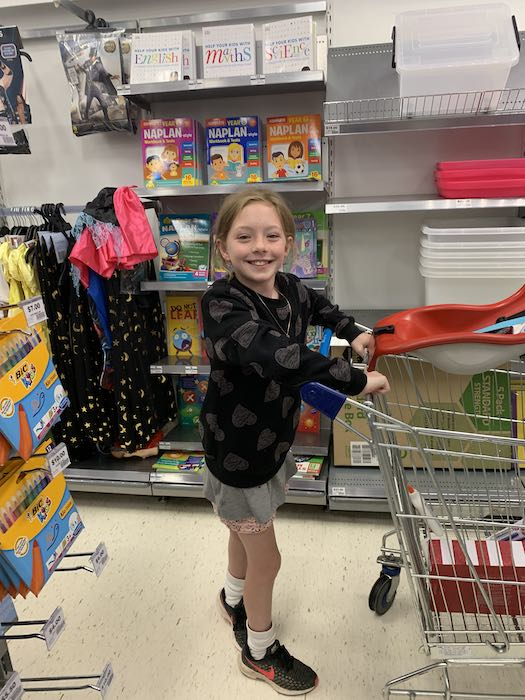 Julia loves shopping with her own money. Her Wonder Woman Spriggy Pre-Paid Debit card gives her independence and is teaching her about money.