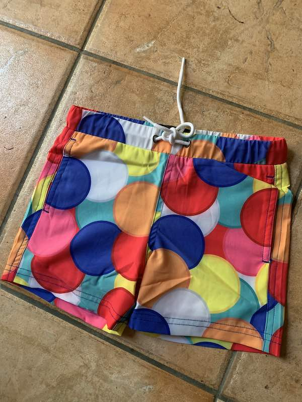 Class of 84 Clothing Mini hundreds and thousands board shorts.