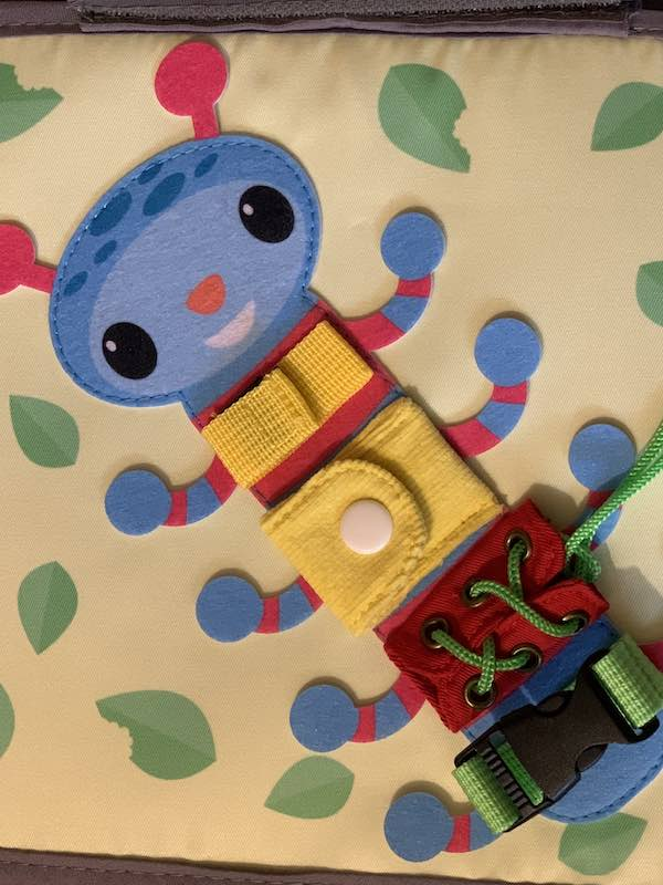 This caterpillar is a multi-purpose page, learn to open and close many items and tie knots or bows.