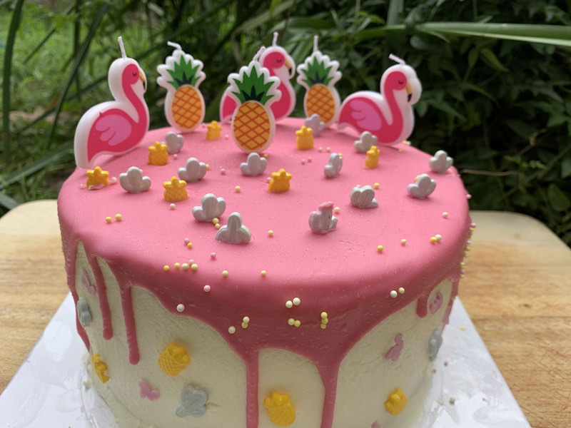 Our summer-inspired Coles Vanilla Pink Drip Cake