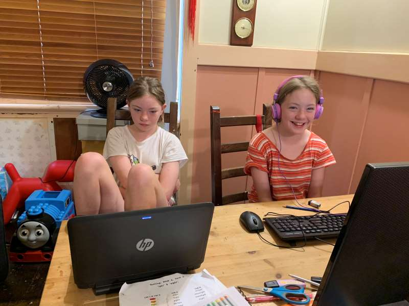 Working hard at their school work - I had to coax a smile out of one of them, the other one decided she didn't want to cooperate