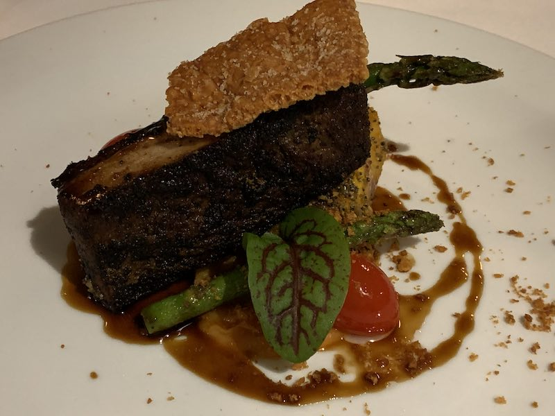 Slow-cooked black garlic & Rosemary Pork Belly, with Sweet Potato Puree, Asparagus, Gourmet Tomatoes, and Smoked Jus
