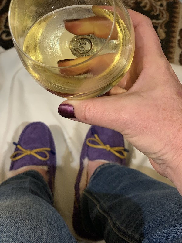 Keeping warm in my new purple UGG Moccasins and relaxing with a glass of wine